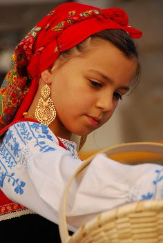 In August every year the town of Viana do Castelo, Portugal celebrates the Festival of Nossa Senhora d'Agonia. This is one of the beautiful girls of the Minho region dressed in traditional costume. Photo: /Grant #world_cultures