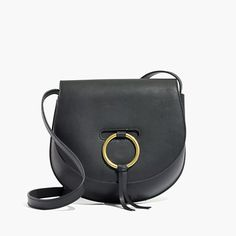 Sleek and structured, this '70s-inspired saddlebag has a cool custom ring closure. Made from rich gets-better-with-age leather, it can totally handle the day-to-night thing. <ul><li>Made of semi vegetable-tanned leather that burnishes beautifully.</li><li>Please note: As it is made of a natural material, each bag varies slightly in texture and color.</li><li>O-ring closure.</li><li>Interior pocket.</li><li>19...