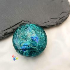 Excited to share the latest addition to my #etsy shop: Blue Rainbow Lentil Set on a cool blue glass laid over shimmering palladium. Decorated with the finest rainbow dichroic and a fine black detail. One side is smooth and the other side has some texture surface detail. Trudi x #glitteringprizeglass #lampwork #focal #dichroic #aqua #glass #jewelrymaking #blue #rainbow http://etsy.me/2jtVkWA