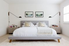 """The master bedroom is one of Lada's favorite moments. The upholstered <a href=""""http://www.westelm.com/products/wrh-mod-upholstered-bed-frame-h917/?pkey=cbeds%7C%"""" target=""""_blank"""">bed</a> framed by symmetrical <a href=""""http://www.cb2.com/mantis-wall-sconce/s440156"""" target=""""_blank"""">sconces</a> and nightstands... you can just crawl in, relax, and disconnect."""