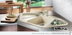 15 Cool Corner Kitchen Sink Designs - Dahab Kitchen | Image: The Kitchen Dahabs | The shape of this corner sink is similar to the others we have in this list, they just very in sizes and colors, like this one for example, it is beige in color and sure is pretty because of the dark counters.