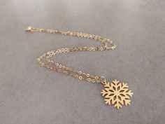 Beautiful snowflake pendant, threaded on a delicate gold-filled chain, the perfect gift for christmas. Made of gold plated brass base, Matte finished. Pendant Dimensions: inch / cm Necklace length: inch / 42 cm Item will be shipped in a branded gift box. Triangle Necklace, Geometric Necklace, Geometric Jewelry, Layered Necklace, Christmas Necklace, Accesorios Casual, Boho, Bridal Jewelry, Etsy Jewelry