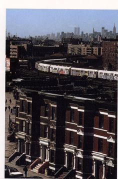 I love the layered effect almost foothills rising into mountains...but here brooklyn town houses, the el, taller buildings, manhattan in the distance  with the twin towers, the empire state, the crysler building...the sky.