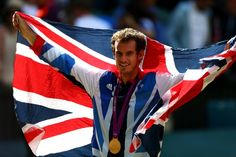 Gold medalist Andy Murray of Great Britain poses during the medal ceremony for the Men's Singles Tennis match on Day 9 of the London 2012 Olympic Games at the All England Lawn Tennis and Croquet Club on August 5, 2012 in London, England. Murray defeated Federer in the gold medal match in straight sets 2-6, 1-6, 4-6.
