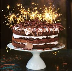 JAMIE OLIVER'S CHCOLATE CELEBRATION CAKE. A real showstopper topped with a nougat frosting this is the perfect cake for a celebration. Find more cakes and bakes at housebeautiful.co.uk