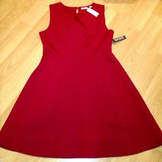 SALENWT fit snd flare style quilted dress Beautiful quilted sleeveless dress with keyhole button on back. Size large but dress has stretch so its very figure flattering for a few different sizes. Color is a rich burgundy. New York & Company Dresses