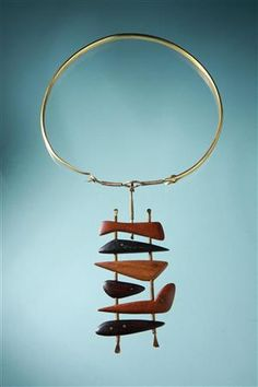 """Necklace, designed by Torun Bülow-Hübe, Sweden. Late 1940s, early 1950s. Brass and handcarved hardwoods. Length of pendant 5""""."""