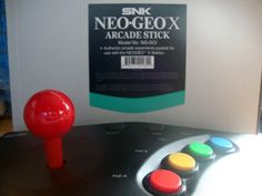 This is a Brand New Neo Geo X stick. Has been fitted with 24mm Seimitsu buttons for better response and feel. Also has a 35mm Sanwa red ball for better grip as well as red shaft cover. Theme is to replicate the controls on a Super Neo 29 arcade cab.
