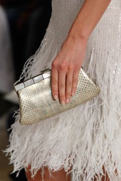 A simple clutch bag is a perfect finish with an elegant party dress