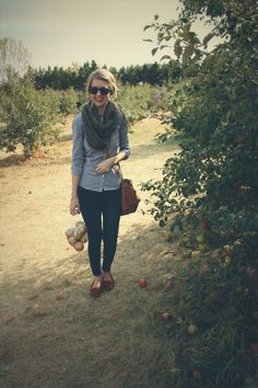 Fall fun at the apple orchard! Chelsea rocking her feather mocs while picking apples! via zippedblog