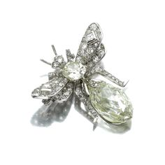 DIAMOND BROOCH. Designed as a bee set with rose-, single-, square-, circular-cut and cushion-shaped diamonds, the abdomen set with a briolette diamond, mounted in white gold, French assay and maker's marks.