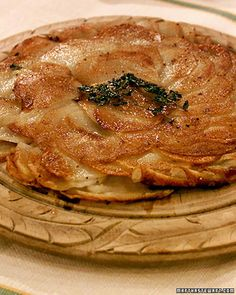 A staple of the French countryside, potato galette is an ideal accompaniment to roasted chicken or beef tenderloin. Be sure to use clarified butter, which will not burn as quickly as regular butter during the galette's long cooking time.