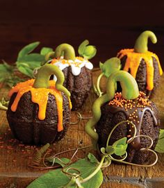 Mini pumpkin cupcakes.  Baked in individual Bundt pans.  Two joined together & drizzled with glaze.  Sprinkle with coarse sugar & marzipan stems.  So pretty!