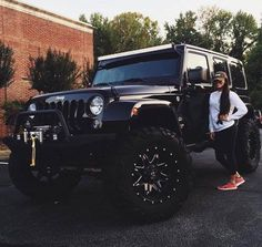 Girl standing next to Large black jeep woth large wheels. Girl standing next to - -Large black jeep woth large wheels. Girl standing next to - - Auto Jeep, Maserati, Bugatti, Jeep Carros, Dream Cars, Girly Car, Bmw Autos, Jeep Truck, Luxury Sports Cars