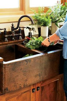 Hammered Copper sink & bronze faucet in the farmhouse kitchen! ♥ Nice deep bowls and copper is very forgiving if you drop a plate while washing dishes or cooking. #Design #Home #Rustic