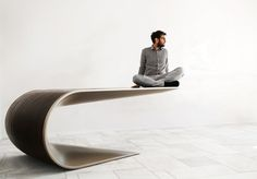 """Bent  design: eleftherios ambatzis The inspiration for Bent comes from the idea of bending a sheet of metal to form a new elevated horizontal level. Half a ton in weight, the steel desk appears as though it is about to fall, but is perfectly weighted and very stable due to a complex structure hidden under its """"skin"""". dimensions: 120X260 cm. Mykonos, Furniture Design, Steel, Bending, Chair, Elegant, Room, Objects, Inspiration"""