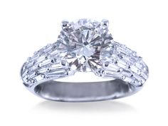 Alson Signature Collection Engagement Ring, Fashioned in 18K White Gold, Featuring a 2.70 Carat Round Diamond, SI1 Clarity, L Color, GIA Certified, Accented with Fifty-Two Baguette Diamonds =1.78cts Total Weight
