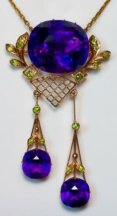 Antique Russian Siberian Amethyst and Demantoid Garnet Rose Gold Pendant Necklace    made in Moscow between 1908 and 1917    Three deep velvet purple Siberian amethysts, sixteen Ural demantoids, 56 zolotniks rose and yellow gold