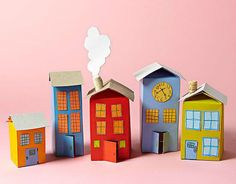 Easy craft projects from everyday items. A few simple snips and a coat of paint transform milk cartons into a colorful village.