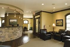 I like the closed area for incoming and outgoing patients. photos of dental reception areas | Reception Area