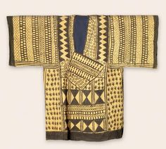 Africa | Man's shirt. Yalunka peoples.  Sierra Leone, Kalia | Cotton, natural dye | This dye-stamped, patterned shirt is typical of the Yalunka peoples. It was brought to Bafodea, a center of the Limba peoples who learned dye stamping from the Yalunka. Its complex design motifs would have conferred status and prestige on the wearer.