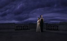 dramatic night wedding portrait of bride and groom on the rooftop of the Spokane Club photo by matt Shumate photography