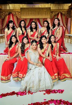 Red sarees. Bridesmaids. Photo by Zamana Lifestyles