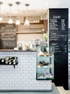 Subway tile counter. Chalkboard wall. Exposed shelving.
