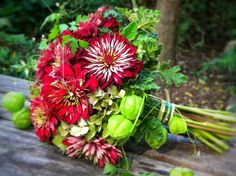 Red Zinnias, Scented Geranium, Green Hydrangea, Love-In-A-Puff Vine, Geranium Foliage + Additional Greenery/Foliage.... Bouquet by Spring Well Gardens Near Raleigh, NC