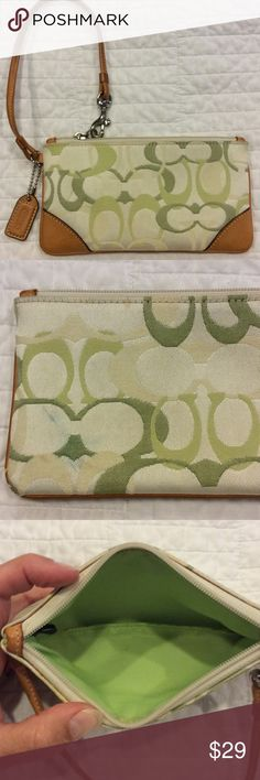 """Canvas & Leather Coach Wristlet Green canvas / brown leather. Authentic Coach. Used condition. The leather is clean. Found some blue or green coloring on backside at be end. Have not tried to clean it. Silver hardware. Inside is mostly clean. Some brown marks under zipper and at very bottom in seam. Overall good condition and nice bag.  7"""" long. 3.75"""" tall. Coach Bags Clutches & Wristlets"""