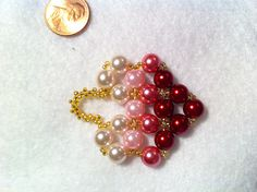 red-rose-pink pearl heart #3  red, rose, pink & white pearl beads (8 mm), gold silver-lined seed beads (size 11); right angle weave stitch & peyote stitch.