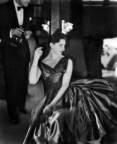 Jane Ingram is wearing silk satin cocktail dress, photo by Eugene Vernier, 1950s