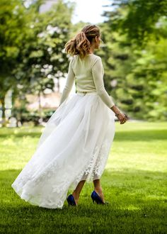 The fashionista and former MTV reality star ditched the traditional dress in favor of three separates by Carolina Herrera: a cream cashmere sweater, white shorts, and a sheer satin and silk tulle skirt.