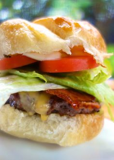 Maple-Bacon Beer Burgers - burgers seasoned with Worcestershire, beer and pepper, topped with Maple Bacon and cheese. SOOOOO good. I could eat the bacon every day!