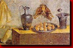 In ancient times, public life began at dawn, so a Roman had little to no time to prepare breakfast. They nibbled a bit of bread dipped in milk or wine, or ate curd cheese with honey, olives, raisins, or nuts. A heavy breakfast was considered unhealthy and vulgar.