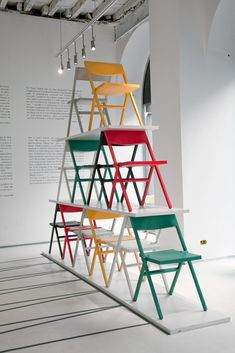 David Chipperfield's Piana folding chair for Alessi, folds completely flat for easy stacking.