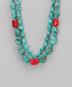 Harness positive energy while emitting a polished, posh look via this beaded beauty. Stones adorned during ancient times stay trendy as turquoise and coral beads sit stylishly against any neckline.18'' longTurquoise / coral / sterling silverImported