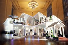 """Target's Life-Size Dollhouse inside Grand Central (NYC) is a perfect example of what we call """"inside- out"""" marketing. This type of tactic generates interest and best communicates your store planning concept to your customers while driving traffic and turning sales. #Target #NYC #PopUpRetail"""