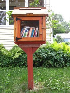 These Little Free Libraries are absolutely adorable [Image via Ali Eminov/Flickr]