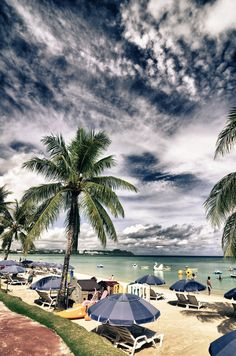 Guam Beachside ~ my Grandfather was stationed here in Guam during WWII. I have a happy photo of him standing in the beach, up to his knees,  wearing a floppy hat & smiling. Must have been a welcomed break.