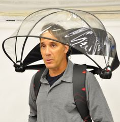 Stay dry with a hands-free umbrella. Smart for back-packers