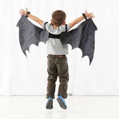 Bat Costume set features a pair of bat wings, so your little one can spend their afternoons zipping through the night and eating all the insects they can. Well, maybe not the insects part.<br /><br /><NEWTAG/><h2>Details, details</h2><ul><li> Nod exclusive, designed by us</li><li> Shoulder and wrist fabric hooks and loop fasteners to hold in place</li></ul><h2>Show 'em what you're made of</h2><ul><li> 100% vinyl</li></ul><h2>Care instructions</h2><ul><li> Spot clean only</li></ul><h2>Age…