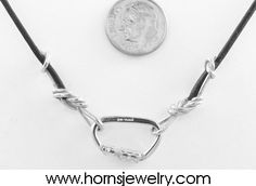 Silver carabiner with leather cord and silver figure eight knots. How cool is that! $64