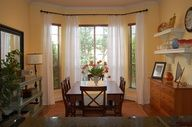 Mirror and plant; mix of wood stains (living room) Image detail for -Bay Window Curtain Ideas - Curtain Ideas - Zimbio