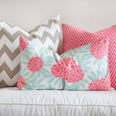 I love the chevron pillow! My husband would never let me have so much pink on our sofa though. Men!