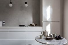 Minimalist kitchen with greige walls, white cabinents and bulb pendant lights Scandinavian Kitchen, Scandinavian Interior, Kitchen Interior, Kitchen Design, Paint My Room, Trending Paint Colors, Interior Decorating, Interior Design, Interior Modern