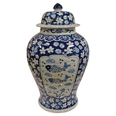 An eye-catching addition to your hallway console table or dining room curio cabinet, this ceramic urn showcases a fish motif in white and blue. $134.95