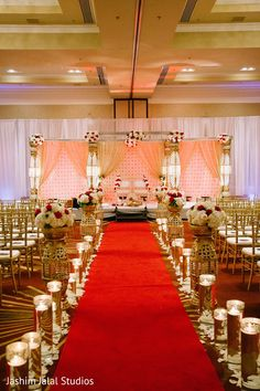 Line walkway with staggered vases - the idea is to re-use these for the centerpieces at the reception.