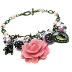 Love this Eiffel Tower and Rose Charm Bracelet