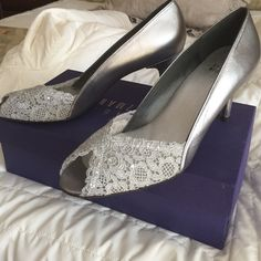 Silver Stuart Weitzman pumps Silver 2 1/2 inch heels, peep toe, lace with small crystals on top- by Stuart Weitzman. Stuart Weitzman Shoes Heels